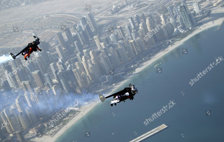 An Aerial View Taken From Behind Airplane's Window Glass Shows Swiss Pilot and Aviation Enthusiast Yves Rossy (r) Known As the Jetman and French Vince Reffett (l) Flying Over Jumeirah Beach Residence (also Known As Jbr) in Dubai United Arab Emirates on 12 May 2015 United Arab Emirates Dubai