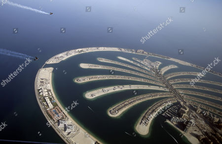 An Aerial View Taken From Behind Airplane's Window Glass Shows Swiss Pilot and Aviation Enthusiast Yves Rossy(bottom) Known As the Jetman and French Vince Reffett (up) Flying Over the Man-made Island of Palm (jumeirah Palm Island) in Dubai United Arab Emirates on 12 May 2015 United Arab Emirates Dubai