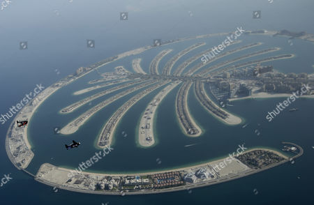 An Aerial View Taken From Behind Airplane's Window Glass Shows Swiss Pilot and Aviation Enthusiast Yves Rossy(r) Known As the Jetman and French Vince Reffett(l) Flying Over the Man-made Island of Palm (jumeirah Palm Island) in Dubai United Arab Emirates on 12 May 2015 United Arab Emirates Dubai