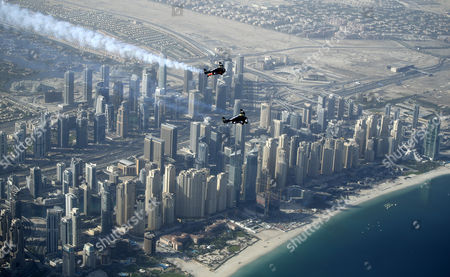 An Aerial View Taken From Behind Airplane's Window Glass Shows Swiss Pilot and Aviation Enthusiast Yves Rossy(bottom) Known As the Jetman and French Vince Reffett (up) Flying Over Jumeirah Beach Residence (also Known As Jbr) in Dubai United Arab Emirates on 12 May 2015 United Arab Emirates Dubai