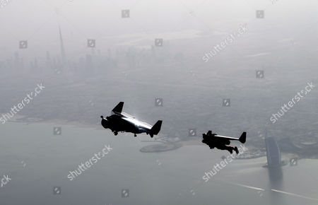 An Aerial View Taken From Behind Airplane's Window Glass Shows Swiss Pilot and Aviation Enthusiast Yves Rossy (l) Known As the Jetman and French Vince Reffett (r) Flying Over the Beach in Dubai United Arab Emirates on 12 May 2015 United Arab Emirates Dubai