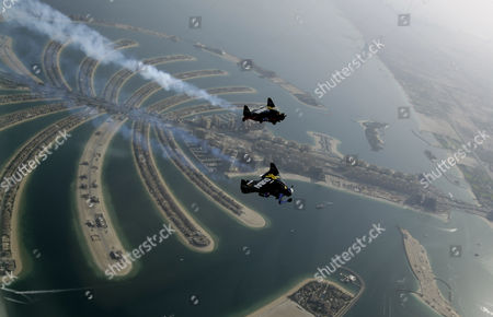 An Aerial View Taken From Behind Airplane's Window Glass Shows Swiss Pilot and Aviation Enthusiast Yves Rossy(front) Known As the Jetman and French Vince Reffett (back) Flying Over the Man-made Island of Palm (jumeirah Palm Island) in Dubai United Arab Emirates on 12 May 2015 United Arab Emirates Dubai