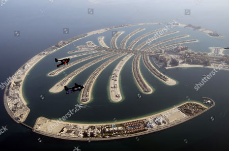 An Aerial View Taken From Behind Airplane's Window Glass Shows Swiss Pilot and Aviation Enthusiast Yves Rossy(front) Known As the Jetman and French Vince Reffett(back) Flying Over the Man-made Island of Palm (jumeirah Palm Island) in Dubai United Arab Emirates on 12 May 2015 United Arab Emirates Dubai