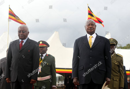 Mozambique President Armando Emilio Guebuza (l) is Escorted by President Yoweri Museveni (r) of Uganda During the 51st Independence Anniversary Celebrations at the Rukungiri District Stadium in Rukungiri Uganda 09 October 2013 Uganda Gained Independence From Britain on 09 October 1962 Uganda Rukungiri