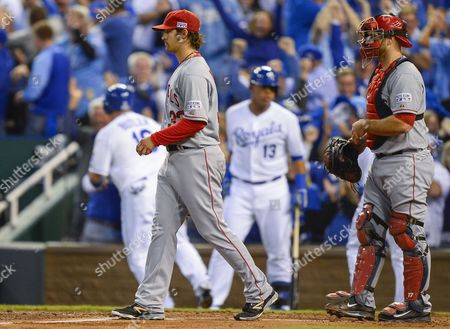 Los Angeles Angels Starting Pitcher C J Wilson (l) Walks Back to the Mound As Los Angeles Angels Catcher Chris Iannetta (r) Looks on After Wilson Gave Up a Three-run Double to Kansas City Royals Left Fielder Alex Gordon in the First Inning of Game Three of Their American League Division Series Mlb Playoff Baseball Game at Kauffman Stadium in Kansas City Missouri Usa 05 October 2014 United States Kansas City