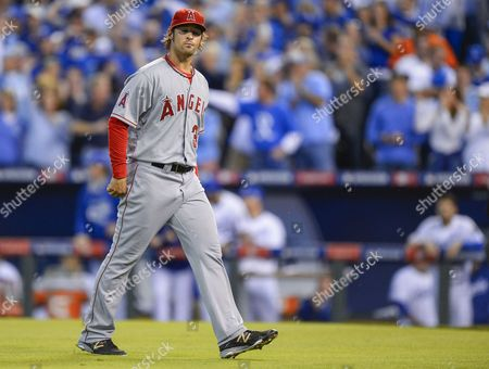 Los Angeles Angels Starting Pitcher C J Wilson Walks Off the Field After Giving Up a Three-run Double to Kansas City Royals Left Fielder Alex Gordon in the First Inning of Game Three of Their American League Division Series Mlb Playoff Baseball Game at Kauffman Stadium in Kansas City Missouri Usa 05 October 2014 United States Kansas City