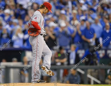 Los Angeles Angels Starting Pitcher C J Wilson Kicks the Dirt on the Mound After Giving Up a Three-run Double to Kansas City Royals Left Fielder Alex Gordon in the First Inning of Game Three of Their American League Division Series Mlb Playoff Baseball Game at Kauffman Stadium in Kansas City Missouri Usa 05 October 2014 United States Kansas City