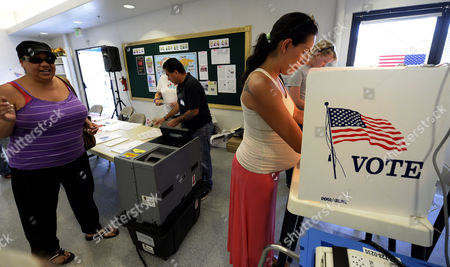 Latina Voter Ana-maria Baneulos (r) Marks Her Ballot at a Polling Station in the San Fernando Valley Neighborhood of North Hills During a Special Run-off Mayoral Election in Los Angeles California Usa 21 May 2013 Democratic Candidates Eric Garcetti and Wendy Greuel Are in a Tight Race and Latino and Older White Male Voters Are Expected to Decide the Election United States West Hills