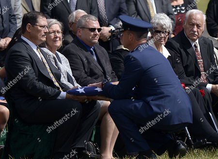 Janes Sizemore (l) with His Sister Rebecca Sizemore (2-l) Brad Andre (3-l) and Judith Andre (2-r) Receives the American Flag That Draped His Fathers Casket by Us Air Force Chaplin Captian Travis Spears (3-r) During the Full Military Honors Funeral Services For His Father Air Force Major James Sizemore and Major Howard Andre at Arlington National Cemetery in Arlington Virginia Usa 23 September 2013 Major Andre and Major Sizemore Were Killed when Their A26 Bomber Which Had Been Used in the Second World War was Shot Down During a Night Reconnaissance Mission in Laos During the Vietnam War in 1969 United States Arlington