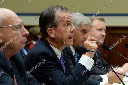 Retired Navy Admiral and Vice Chairman of the Benghazi Accountability Review Board Michael Mullen (2-l) Answers a Question During the Us House Oversight and Government Reform Committee Hearing on 'Reviews of the Benghazi Attacks and Unanswered Questions' on Capitol Hill in Washington Dc Usa 19 September 2013 the Us Mission in Benghazi Libya was Attacked 11 September 2012 Resulting in the Death of Ambassador J Christopher Stevens and Three Other Americans United States Washington