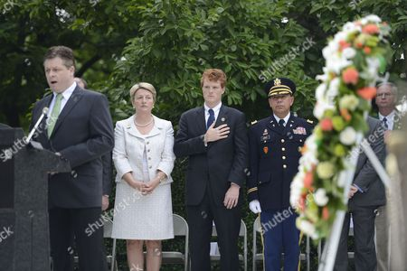 Us Congressman Joseph Kennedy Iii (c) Listens to the National Anthem at the Gravesite of Us President John F Kennedy During a Flame Lighting Ceremony at Arlington National Cemetery in Arlington Virginia Usa 18 June 2013 the Eternal Flame Will Light a Torch That Will Be Carried to New Ross County Wexford Ireland where It Will Light Another Eternal Flame at a Memorial Commemorating the 50th Anniversary of President Kennedy's Visit to Ireland in 1963 United States Arlington