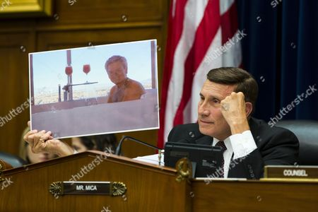 Republican Congressman From Florida John Mica (r) Holds Up a Picture of Jeff Neely the Organizer of an Irs Conference who was Photographed in a Hot Tub at a House Oversight and Government Reform Committee Hearing Entitled 'Collected and Wasted: the Irs Spending Culture and Conference Abuses' in the Rayburn House Office Building in Washington Dc Usa 06 June 2013 United States Washington
