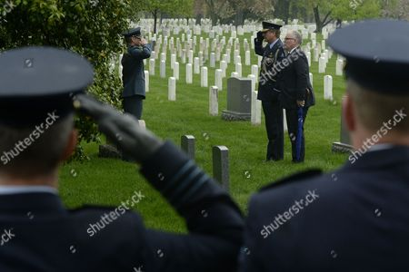 Minister of Foreign Affairs of the Netherlands Frans Timmermans (2-r) Visits the Grave of Second Lieutenant Bernardus Pieter De Wit of the Royal Netherlands Marines Beside Defense Attache of the Netherlands Air Commodore Ralph Reefman (3-r) and Lieutenant Colonel of the Royal Netherlands Air Force Perry Sommers (2-l) in Section 15 of Arlington National Cemetery in Arlington Virginia Usa 30 April 2014 Timmermans Visited the Graves of Four Dutch Service Members the Women in Military Service For America Memorial and the Tomb of the Unknown Soldier During His Visit to Arlington National Cemetery United States Arlington