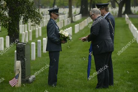 Minister of Foreign Affairs of the Netherlands Frans Timmermans (front R) Visits the Grave of Second Lieutenant Bernardus Pieter De Wit of the Royal Netherlands Marines Beside Defense Attache of the Netherlands Air Commodore Ralph Reefman (back R) and Lieutenant Colonel of the Royal Netherlands Air Force Perry Sommers (l) in Section 15 of Arlington National Cemetery in Arlington Virginia Usa 30 April 2014 Timmermans Visited the Graves of Four Dutch Service Members the Women in Military Service For America Memorial and the Tomb of the Unknown Soldier During His Visit to Arlington National Cemetery United States Arlington