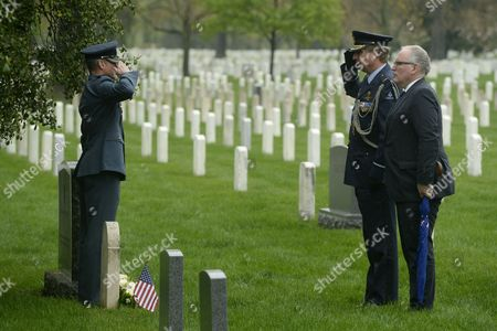 Minister of Foreign Affairs of the Netherlands Frans Timmermans (r) Visits the Grave of Second Lieutenant Bernardus Pieter De Wit of the Royal Netherlands Marines Beside Defense Attache of the Netherlands Air Commodore Ralph Reefman (2-r) and Lieutenant Colonel of the Royal Netherlands Air Force Perry Sommers (l) in Section 15 of Arlington National Cemetery in Arlington Virginia Usa 30 April 2014 Timmermans Visited the Graves of Four Dutch Service Members the Women in Military Service For America Memorial and the Tomb of the Unknown Soldier During His Visit to Arlington National Cemetery United States Arlington