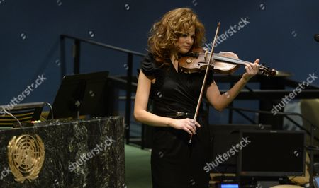 Stock Photo of Violinist Miri Ben-ari of the United States Performs During the United Nations Memorial Ceremony to Mark the International Day of Commemoration in Memory of the Victims of the Holocaust in the General Assembly Hall at United Nations Headquarters in New York New York Usa 28 January 2015 United States New York
