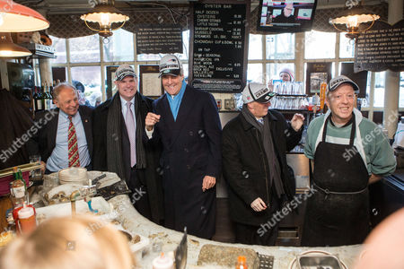(l-r) Owner of the Union Oyster House Joseph Milano Stands with Canadian Foreign Minister John Baird United States Secretary of State John Kerry Mexican Foreign Secretary Jose Antonio Meade and Employee Jimmy Mcdonnell Behind the Raw Bar and at the Union Oyster House in Boston Massachusetts Usa 31 January 2015 All Three Wore New England Patriots Hats Secretary of State Kerry is Hosting the North American Ministerial Trilateral Meeting United States Boston