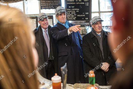 United States Secretary of State John Kerry (c) Stands Behind a Raw Bar with Canadian Foreign Minister John Baird (l) and Mexican Foreign Secretary Jose Antonio Meade (r) at the Union Oyster House in Boston Massachusetts Usa 31 January 2015 All Three Wore New England Patriots Hats Secretary of State Kerry is Hosting the North American Ministerial Trilateral Meeting United States Boston