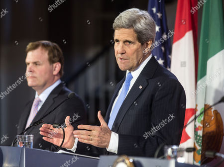 Stock Photo of United States Secretary of State John Kerry (r) and Canadian Foreign Minister John Baird (l) Speak During a Press Conference at Historic Faneuil Hall in Boston Massachusetts Usa 31 January 2015 Secretary of State Kerry is Hosting the North American Ministerial Trilateral Meeting United States Boston