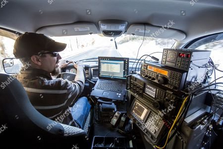 A Photograph Made Available on 31 January 2014 Shows Technician Jonah Bauserman Patrolling the Area Surrounding the National Radio Astronomy Observatory in a Radio Detection Truck Looking For Radio Frequencies Violating the Region's Restrictions on Wireless Communications in Sugar Grove West Virginia Usa 30 January 2014 to Protect the Observatory From Radio Interference the Federal Communications Commission Designated 13 000 Miles (20 921 Km) Surrounding the Facility As a National Radio Quiet Zone where Wireless Communications Such As Radio Cell Phone and Wi-fi Are Severely Restricted United States Green Bank