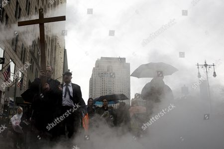 Firefighter John Bartlett of Engine 167 in Staten Island Holding the Cross in Lower Manhattan During a 'Way of the Cross' Procession Over the Brooklyn Bridge to Remember the Stations of the Cross Related to the Hours of Jesus Christ's Life Before His Crucifixion on Good Friday in New York New York Usa 03 April 2015 United States New York