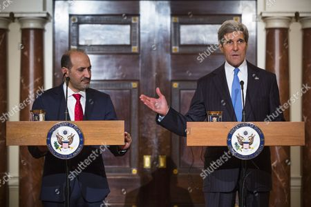 Us Secretary of State John Kerry (r) Talks to the Media Before Meeting with Syrian Opposition Coalition President Ahmad Al-jarba (l) at the State Department in Washington Dc Usa 08 May 2014 Al-jarba is in Dc Lobbying For Better Arms to Fight Syrian President Bashar Al-assad's Forces United States Washington