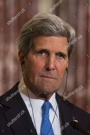 Us Secretary of State John Kerry Listens to Syrian Opposition Coalition President Ahmad Al-jarba (not Pictured) Talk to the Media Before Their Meeting at the State Department in Washington Dc Usa 08 May 2014 Al-jarba is in Dc Lobbying For Better Arms to Fight Syrian President Bashar Al-assad's Forces United States Washington