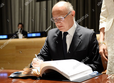 Hector Marcos Timerman Argentina's Minister of Foreign Affairs Signs the Arms Trade Treaty at United Nations Headquarters in New York New York Usa 03 June 2013 This is the First International Treaty Regulating the Multibillion-dollar Global Arms Trade the Treaty Requires Countries That Ratify It to Establish National Regulations to Control the Transfer of Conventional Arms and to Regulate Arms Sellers But Does Address the Domestic Use of Weapons in Any Country at Right is Patricia O'brien Under-secretary-general For Legal Affairs and United Nations Legal Counsel United States New York