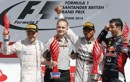 British Formula One Driver Lewis Hamilton of Mercedes Amg Gp (2-r) Celebrates His Victory with Mercedes Designer Director John Owens (2-l) Second-placed Finnish Formula One Driver Valtteri Bottas of Williams (l) and Third-placed Australian Formula One Driver Daniel Ricciardo of Red Bull Racing (r) on the Podium After the Formula 1 Grand Prix of Great Britain at Silverstone Race Track Northamptonshire Britain 06 July 2014 United Kingdom Silverstone