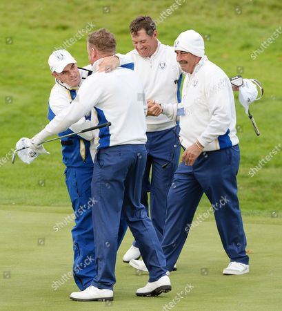 Europe's Ryder Cup Captain Hugs Paul Mcginley (l) Hugs Jamie Donaldson (2-l) While Team Mate Lee Westwood (2-r) is Congratulated by Vice Captain Sam Torrance (r) After Winning Their Fouresomes Match Against Matt Kuchar and Zach Johnson of the Usa on the Second Day of the 40th Ryder Cup at Gleneagles Perthshire Britain 27 September 2014 United Kingdom Gleneagles