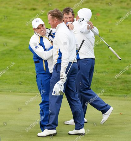 Europe's Ryder Cup Captain Paul Mcginley (l) Hugs Jamie Donaldson (2-l) While Team Mate Lee Westwood (2-r) is Congratulated by Vice Captain Sam Torrance (r) After Winning Their Fouresomes Match Against Matt Kuchar and Zach Johnson of the Usa on the Second Day of the 40th Ryder Cup at Gleneagles Perthshire Britain 27 September 2014 United Kingdom Gleneagles