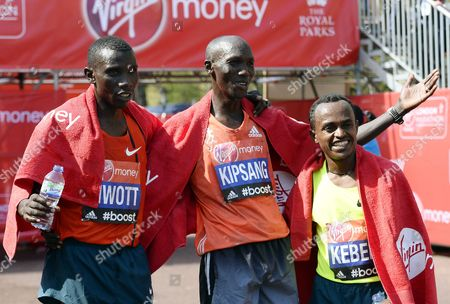 Stock Image of Wilson Kipsang (c) of Kenya Celebrates After Winning the Men's Elite London Marathon in London Britain 13 April 2014 Kipsang Won Ahead of Second Placed Stanley Biwott (l) of Kenya and Third Placed Tsegaye Kebede (r) of Ethiopia United Kingdom London