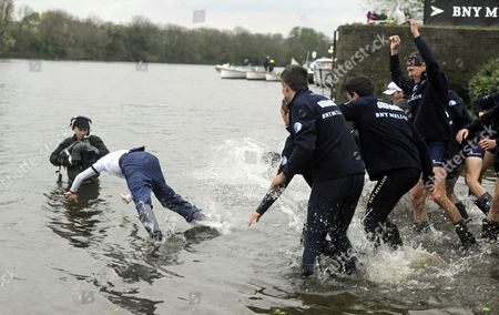 Stock Picture of Oxford University Throw Their Cox Laurence Harvey (l) Into the River Thames After Beating Cambridge University in the Annual Boat Race on the River Thames From Putney Bridge to Mortlake Britain 06 April 2014 United Kingdom London