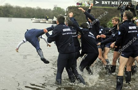 Oxford University Throw Their Cox Laurence Harvey (l) Into the River Thames After Beating Cambridge University in the Annual Boat Race on the River Thames From Putney Bridge to Mortlake Britain 06 April 2014 United Kingdom London