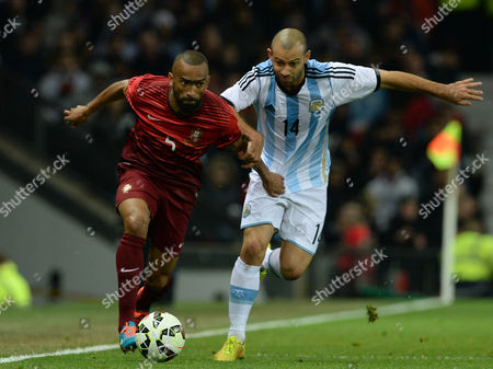 Stock Image of Argentina's Javier Mascherano (r) Challenges Portugal's Jose Bosingwa During the International Friendly Soccer Match Between Argentina and Portugal at Old Trafford Manchester Britain 18 November 2014 United Kingdom Manchester