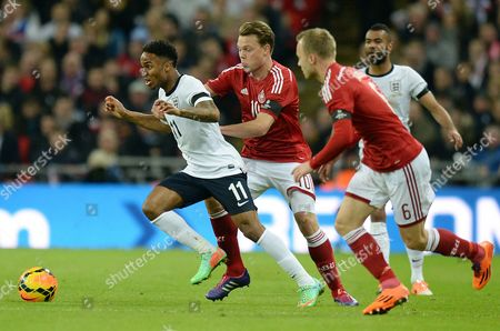 England's Raheem Sterling in Action Against Denmark's Lars Jacobsen (r) and Emil Larsen (c) During the International Soccer Friendly Match Between England and Denmark at Wembley Stadium in London Britain 05 March 2014 United Kingdom London