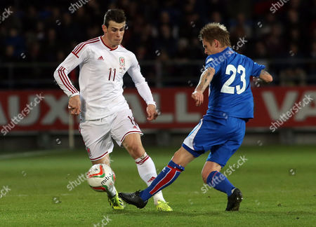 Gareth Bale (l) of Wales and Ari Freyr Skulason (r) of Iceland Vie For the Ball During the International Soccer Friendly Match Between Wales and Iceland at the Cardiff City Stadium in Cardiff Wales Britain 05 March 2014 United Kingdom Cardiff