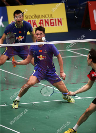 Chai Biao (c) and Hong Wei (l) of China in Action Against Lee Yong Dae and Yoo Yeon Seong of Korea During Their Men's Doubles Match at the Bca Indonesia Open 2015 Badminton Tournament in Jakarta Indonesia 05 June 2015 Indonesia Jakarta