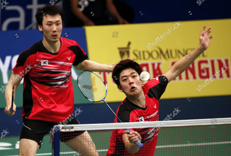 Lee Yong Dae (r) and Yoo Yeon Seong (l) of Korea in Action Against Chai Biao and Hong Wei of China During Their Men's Double Match at the Bca Indonesia Open 2015 Badminton Tournament in Jakarta Indonesia 05 June 2015 Indonesia Jakarta