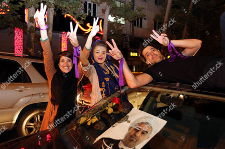 Supporters of Newly-elected Iranian President Hassan Rouhani Celebrate in the Streets After the Official Announcement of Rowhani's Victory in the Presidential Elections in Tehran Iran 15 June 2013 Reformist Candidate Hassan Rouhani Has Won Iran's Presidential Election with More Than 50 Per Cent of Votes Interior Minister Mohammad Mostafa Najar Announced Rouhani Outclassed the Other Five Candidates Especially the Two Close to the Establishment: Hardliner Saeid Jalili and Conservative Ali-akbar Velayati Turnout in Friday's Vote was 72 Per Cent Observers Had Said That in Case of a High Turnout Rouhani Would Also Benefit From Protest Votes Iran (islamic Republic Of) Tehran