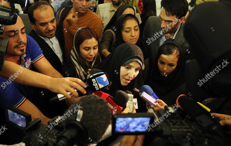 Iranian New Spokeswoman of the Foreign Ministry Marzieh Afkham is Surrounded by Media During a Ceremony in Tehran Iran 01 September 2013 It is For the First Time in Its 34-year-old History That the Islamic Republic of Iran Has Appointed a Woman As Spokesperson For the Foreign Ministry the 47-year-old Afkham Has For Almost Two Decades Been General Director of Different Departments in the Foreign Ministry Including in Charge of Media Affairs Iran (islamic Republic Of) Tehran