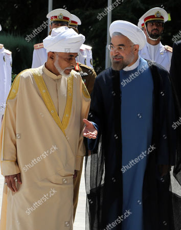 Iranian President Hassan Rouhani (r) Greets Sultan of Oman Qaboos Bin Said Al Said (l) at the Presidential Palace in Tehran Iran 25 August 2013 the Omani Sultan Began a Three-day Visit to Iran the First Since Rowhani Assumed His Post Media Reports Said Sultan Qaboos is Mediating Between Iran and the United States Which Have Had No Diplomatic Ties For Over Three Decades Iran (islamic Republic Of) Tehran