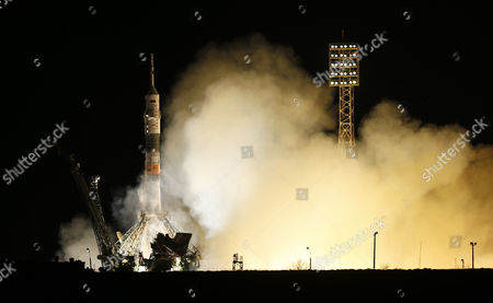 A Rocket Booster Carrying the Soyuz Tma-16m Spacecraft with Member of Expedition 43 Crew Nasa Astronaut Scott Kelly Russian Cosmonauts Gennady Padalka Mikhail Kornienko of the Russian Federal Space Agency (roscosmos) Aboard Lifts Off From the Cosmodrome Baikonur in Kazakhstan 28 March 2015 the Launch of the Soyuz Spacecraft Send Padalka on a Six-month Mission Aboard the International Space Station (iss) and Kelly and Kornienko Will Return to Earth on Soyuz Tma-18m in March 2016 After Their One-year Mission Kazakhstan Baikonur