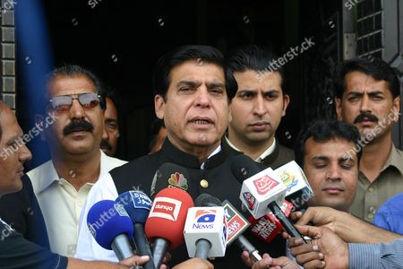 Stock Image of Raja Pervaiz Ashraf Former Prime Minister of Pakistan Ruling Party Pakistan People Party (ppp) Talks with Journalists After Casting His Ballot During Parliamentary Elections in Gujar Khan Punjab Province Pakistan 11 May 2013 Millions of Voters Began Casting Their Ballots 11 May in Pakistan's Key General Elections After a Campaign Marked by Violence the Nationwide Vote Marks the First Time a Civilian Government Would Transfer Power to an Elected Successor After Completing a Full Five-year Term Pakistan Gujar Khan