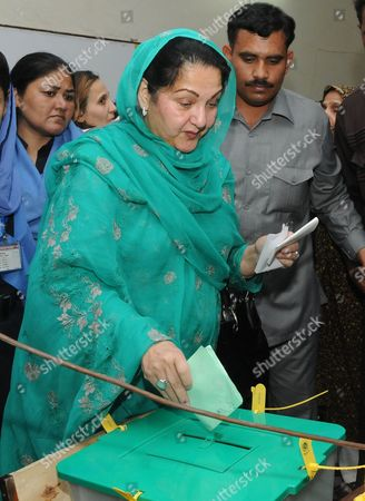 Kalsoom Nawaz (c) Wife of of Nawaz Sharif Former Prime Minister and Leader of Opposition Pakistan Muslim League-nawaz (pml-n) Casts Her Ballot During Parliamentary Elections in Lahore Punjab Province Pakistan 11 May 2013 Millions of Voters Began Casting Their Ballots 11 May in Pakistan?s Key General Elections After a Campaign Marked by Violence the Nationwide Vote Marks the First Time a Civilian Government Would Transfer Power to an Elected Successor After Completing a Full Five-year Term Pakistan Lahore