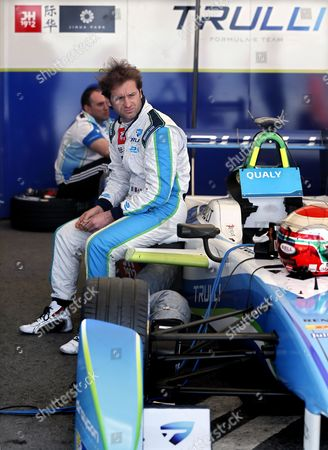 Italy's Formula E Driver Jarno Trulli of Trulli Formula E Team Sits on His Car During the Qualifying Session of the Fia Formula E Race in Moscow Russia 06 June 2015 Russian Federation Moscow