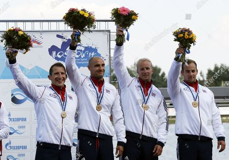 Third Placed Edward Mckeever Liam Heath Jonathan Schofiald and Kristian Reeves of Britain Celebrate on the Podium After the Men's K1 Relay 200m Final of the Icf Canoe Sprint World Championships 2014 in Moscow Russia 10 August 2014 Russian Federation Moscow