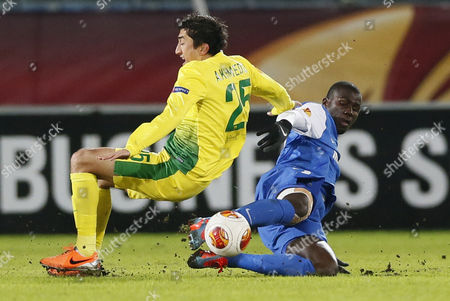 Odil Ahmedov (l) of Fc Anji Makhachkala Vies For the Ball with Kalidou Koulibaly of Krc Genk During the Uefa Europa League Round of 32 First Leg Soccer Match Between Fc Anji Makhachkala and Krc Genk in Ramenskoye Outside Moscow Russia 20 February 2014 Russian Federation Ramenskoye