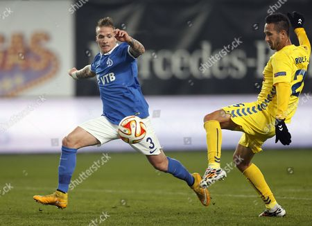 Alexander Buttner (l) of Dinamo Moscow in Action Against Ruben Fernandes (r) of Estoril During the Uefa Europa League Group E Soccer Match Between Dinamo Moscow and Cd Estoril in Khimki Outside Moscow Russia 06 November 2014 Russian Federation Khimki