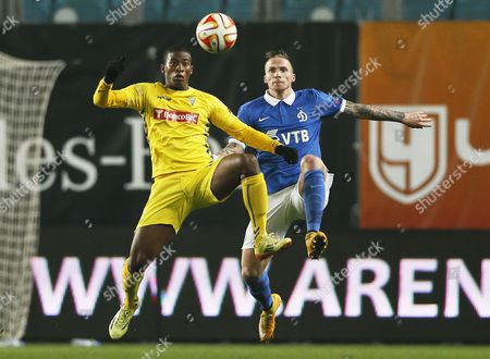 Alexander Buttner (r) of Dinamo Moscow in Action Against Seba (l) of Estoril During the Uefa Europa League Group E Soccer Match Between Dinamo Moscow and Cd Estoril in Khimki Outside Moscow Russia 06 November 2014 Russian Federation Khimki